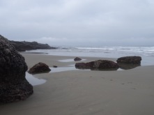 Low tide beach beyond the cliffs