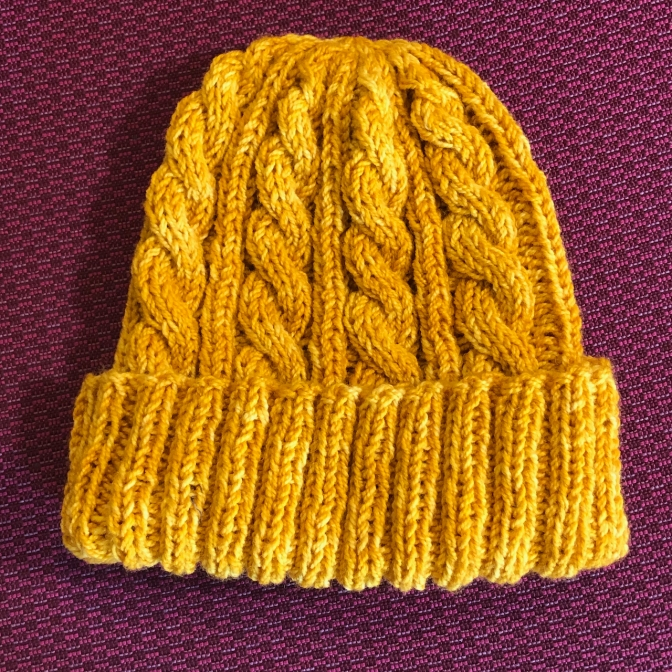 I finished another hat for the guild charity project. Pattern is Jason's Cashmere Hat, yarn is Knit Picks Hawthorne in the Compass color.